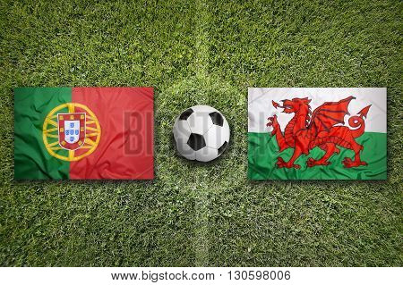 Portugal Vs. Wales Flags On Soccer Field