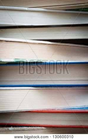 a stack of colorful old yellowed books texture