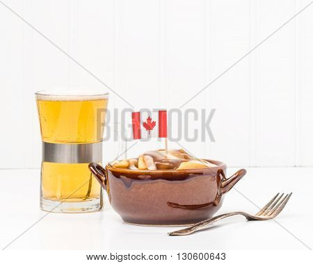 Bowl of poutine a uniquely Canadian dish originating from the Province of Quebec.