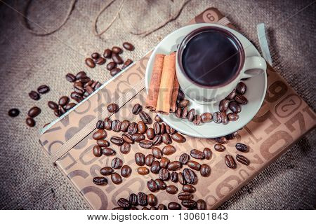 Fragrant Coffee On A Notebook, Espresso Cup And Saucer