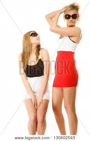 two beautiful sexy crazy women fashion girls in summer clothes sunglasses. Studio portrait isolated on white