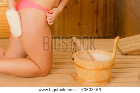 Closeup Of Woman In Sauna With Exfoliating Glove.