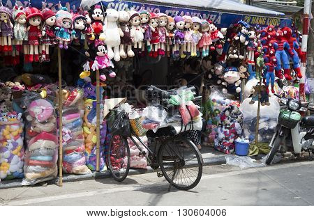 Hanoi, Vietnam - May 14, 2016: Colorful made in China puppet and teddy for sale at low price at Hang Ma old street in Hanoi quarter streets area.