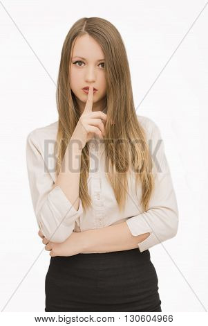 Young succesfull businesswoman gesturing quiet on isolated background