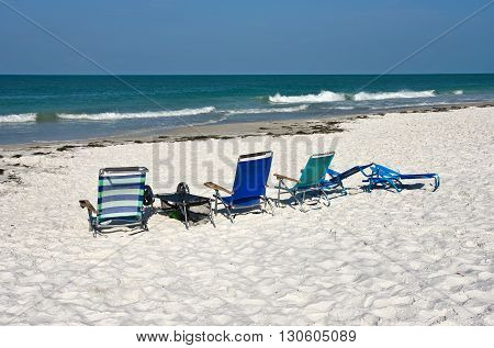 A Group of Beach Chairs on a White Sandy Beach