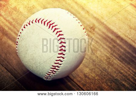 Baseball game. Baseball ball on wooden background. Grunge picture.