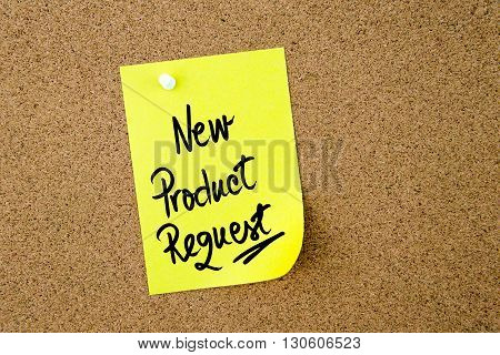 New Product Request Written On Yellow Paper Note