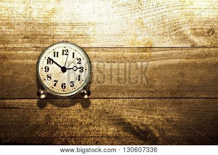 Old clock on the wooden background. Sepia grunge old stylized picture. Time concept.