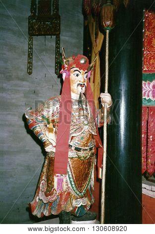 MACAU - CIRCA 1987: A sacred sculpture stands inside the Kun Iam Buddhist Temple in Macau.