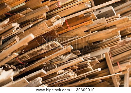 Stack of used lumber for reuse in construction