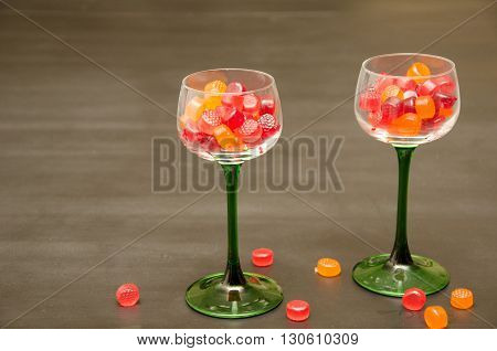 Two Classic Green Stemmed Wine Glasses Accented with Colorful Candy