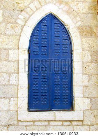 Blue Shutters in Jerusalem of white stone Israel
