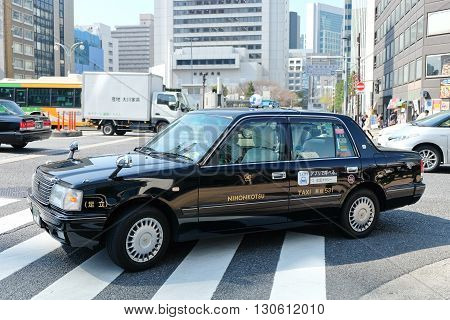 TOKYO, JAPAN -MARCH 29 2016: taxi in the Shin-Ohashi-dori Street on MARCH 29, 2016 in Tokyo,Japan