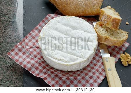 French camembert on a red squares tablecloth