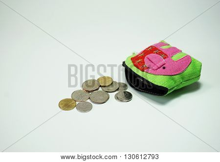 Thai Coins falling from purse on white background