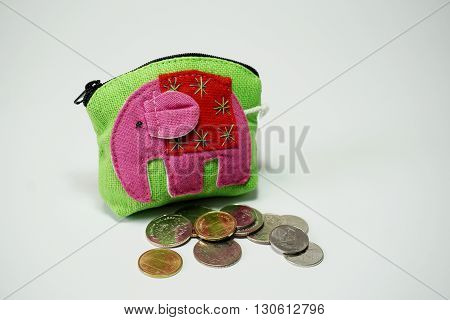 Thai style purse and coin close-up on white background