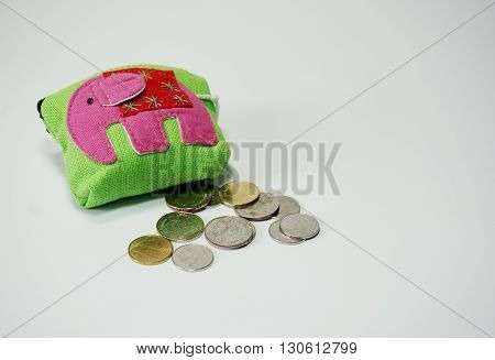 Thai style purse and coin on white background