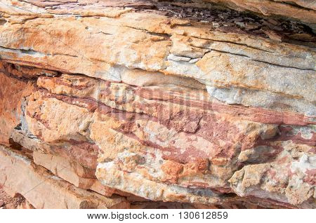 Closeup of red and white banded tumblagooda sandstone natural rock formations in Kalbarri National Park in Kalbarri, Western Australia.