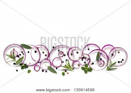 Food background with red onion rings, peppercorns and herbs over white.