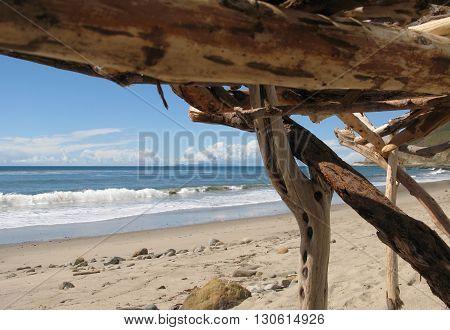 Driftwood fort on beautiful empty beach near Ventura, California.