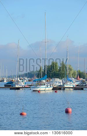 LAPPEENRANTA, FINLAND - AUGUST 09, 2015: August morning on the Saimaa lake.  Yachts and boats moored in the port Lappeenranta, Finland