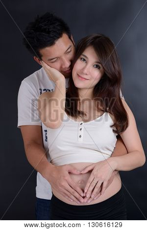 The Beautiful young asian couple expecting baby