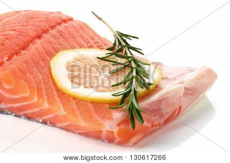 Fresh Raw Salmon Fillet With Lemon Isolated On White