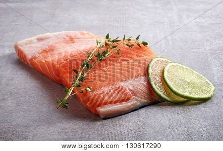 Fresh Raw Salmon Fillet With Lime And Rosemary