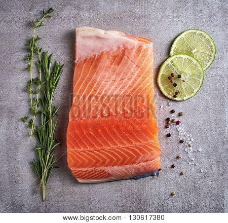 Fresh Raw Salmon Fillet With Lime, Rosemary, Pepper And Salt