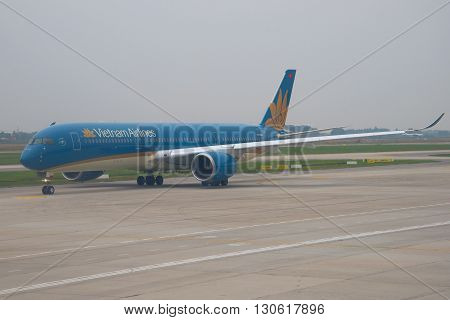 HANOI, VIETNAM - JANUARY 12, 2016: The Airbus A350 (VN-A888) Vietnam Airlines early in the morning on the tarmac of the airport Noi Bai