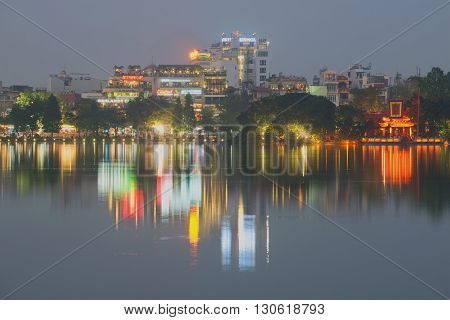 HANOI, VIETNAM - DECEMBER 13, 2015: Hoan Kiem lake in the evening dusk. The historical center of Hanoi. Tourist landmark of the city Hanoi, Vietnam