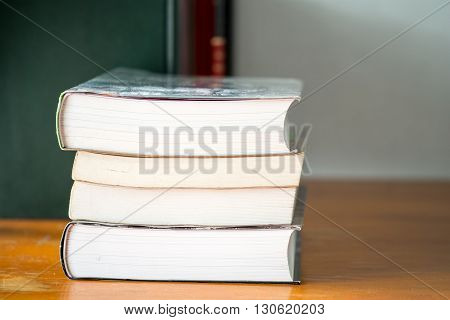 Textbook on the wooden table and white background.
