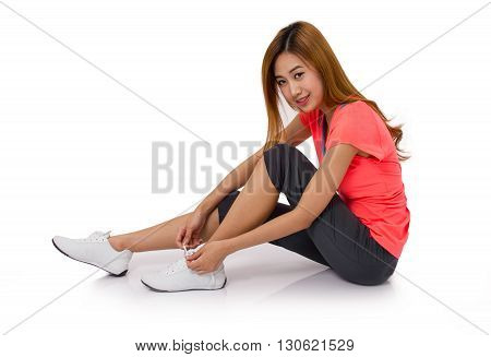 Asian young woman tying running shoes laces Isolated on white.
