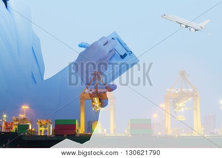 Container cargo freight ship with working crane loading.