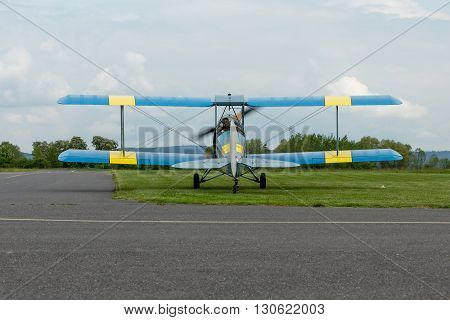 Pribram CZE - MAY 20 2016: DH 82c TIGER MONTH - replica biplane on runway at airport Pribram