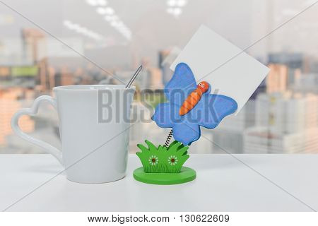 Butterfly Paper note holder and a cup of coffee