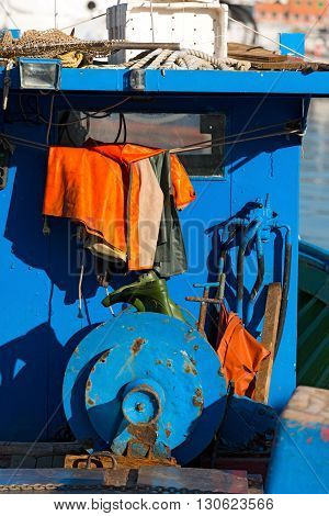Detail of an old blue fishing boat docked in port - La Spezia Liguria Italy