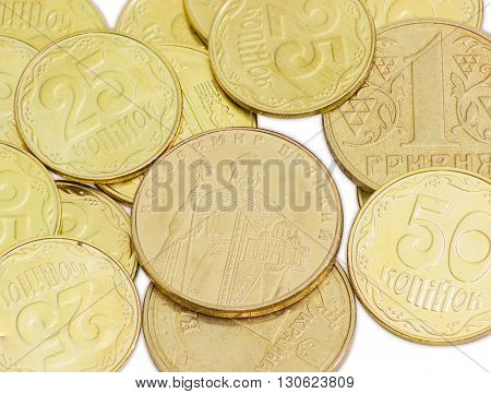 Some coins of the Ukrainian hryvnia different denominations closeup on a light background