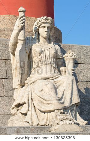 SAINT PETERSBURG, RUSSIA - MARCH 28, 2016: The sculpture at the foot of the North the Rostral columns close up. Historical landmark of the city Saint Petersburg, Russia