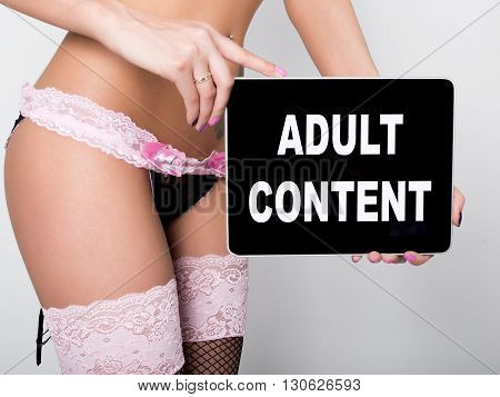 technology, internet and networking - close-up ass of girl in lacy lingerie, holding a tablet pc with adult content sign. Adult content.