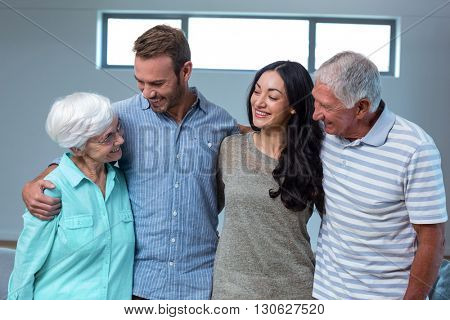 Young couple with their grandparents in living room