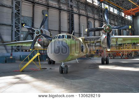 Kiev Ukraine - August 3 2011: Antonov An-32 cargo plane being assembled at the aircraft manufacturing hangar