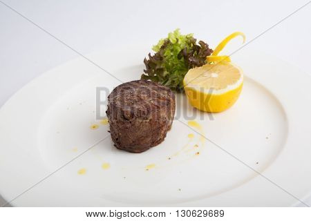 Fried or grilled mignon steak on a white background