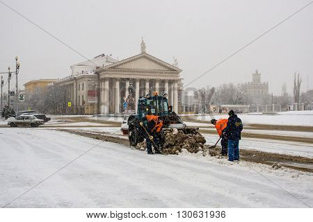 Volgograd, Russia - January 15 2012: Workers clean snow on the Ploshhad' Pavshih Borcov (the Square of the Fallen Fighters) in Volgograd