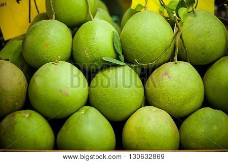 Selection of fresh pomelo fruits. Traditional thai market.