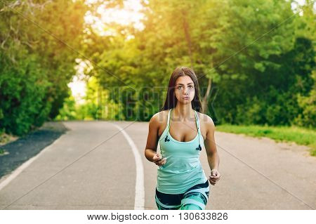 Young woman running in the Park . Sports girls