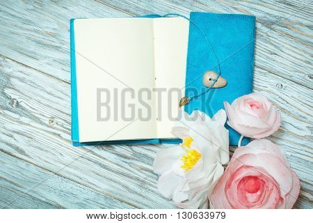 notes and flowers on old boards top view