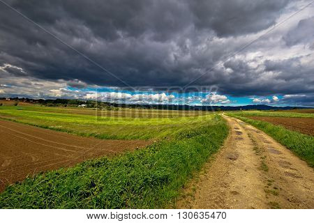 Stormy clouds above countryside road miholec village Prigorje region of Croatia