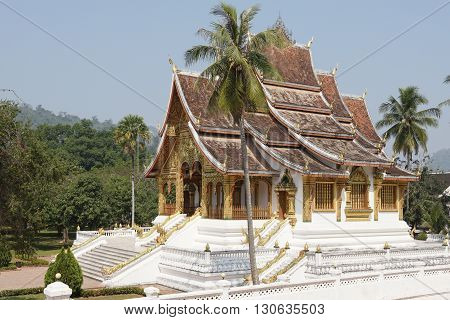 LUANG PROBING, LAOS - FEBRUARY 10, 2016: Wat Ho Pha Bang temple close to the National Museum on February 10, 2016 in Luang Prabang, Laos, Asia