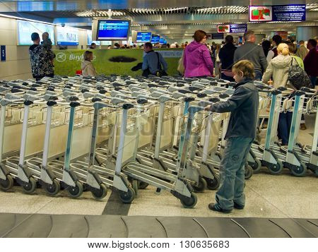 MOSCOW, Russia - May 14 2013, Passengers in the baggage reclaim hall of Vnukovo Airport, Moscow